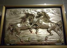 لوحة خيول من فضة
