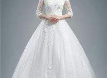 تصفية بدلات زفاف وفساتين سهرة