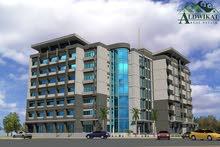 مجمع تجاري للبيع في شارع المدينة الطبية بدخل جيد مساحة الارض 1300 م مساحة البناء 4500 م