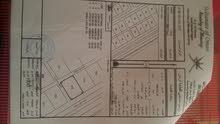 أرض سكنية في سور المزاريع كورنر خط أول (فرصه نادره)