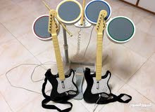 WII ACCESSORIES -Drums set & 2 Guitars - AED 500