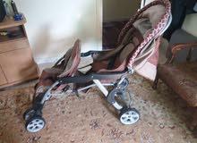 عربة اطفال  .  2 مقعد