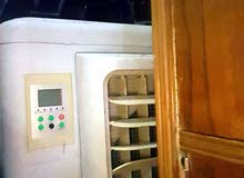 مبردة داخلية الحجم كبير مستعملة لمدة 7 ايام فقط جهاز تحكم عن بعد