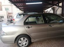 للبيع سياره لانسر2004