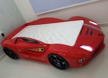 سرير على شكل سيارة