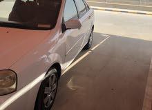 شفر اوبترا 2006 اللون ابيض الحاله جيده للبيع 400دك او للبدل مع تويوتا كرولا او هوندا