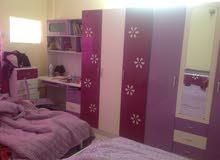 شقة ملك صرف للبيع في مجمع حي الحسين السكني