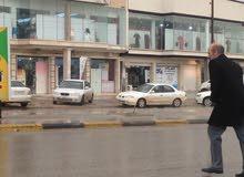 منطقة الجزيره مصراته مقابل الشعبية القديمة بجانب برج مصراته وصالة البركة ومحل