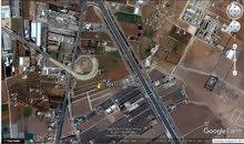أرض للبيع في ام العمد قرب شارع المطار