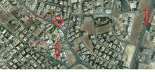 قطعة ارض تجاري في منطقة ام السماق للبيع