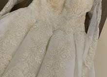 فستان زفاف ابيض لم يستخدم ولم يلبس جديد
