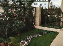 شقة ارضية دوبلكس شبه فيلا للبيع في جبل عمان مساحة البناء 318 م مع حديقة وتراسات 180م