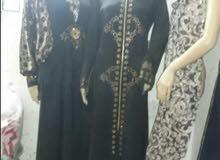 تصفيات ورشة ملابس