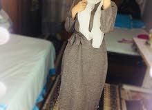 فستان بتصميم بسيط ..قصير بخامه دافئه