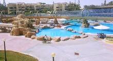 شالية مستوين مجهز بالكامل في مارينا 1 - الساحل الشمالي اطلالة حمامات السباحة