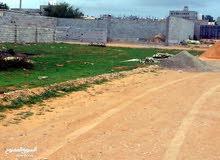 ارض 2052 م مقسمة اربع قطع كل قطعة 427.5 متر تاجوراء البيفي جامع بن حسن