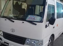 Gasoline Fuel/Power car for rent - Toyota Coaster 2014