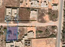 قطعة أرض سكنية للبيع عين زارة الخله قرب عمارات العظم