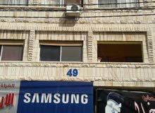 عماره للبيع في الزرقاء شارع باب الواد قرب شركة زين عدم تدخل الوسطاء من المالك مب