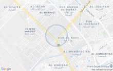 شقة تقاطع العسكري شارع بغداد حي الاحرار مقابل دور النفط العمارات السكنيه