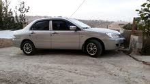 لانسر 2010 ماتور1300 السياره ماشيه 11300 الف