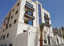 شقة أرضية مع حديقة و ترس و شلال و باربيكيو في حي منصور