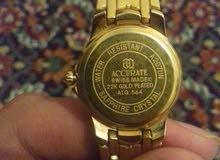 ساعة accurate عليها صورة معمر القذافي