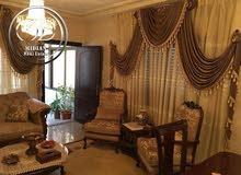 شقة ارضية فارغة للبيع السابع خلف الماكدونالز مساحة 150م مع ترس 40م وكراج خاص