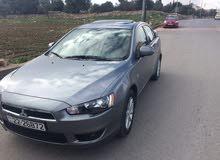 سيارة لانسر GLS 1600 السيارة 7 جيد ماشية 20,000 كيلو فل ما عدا شاشة