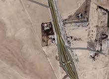 ارض واجهة مباشرة على طريق المطار (ش الدولي )مباشرة