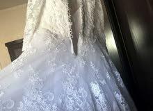 فستان زفاف ملوكي ابيض