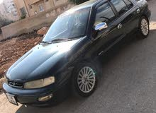 كيا سيفيا 1 لون زيتي  موديل 95  للبيع