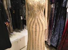 فستان سهره اسود في ذهبي
