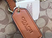 COACH handbag and Calvin Klein bag