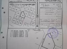 *أرض سكني في المعبيلة المرحلة 2 وسطية مفتوحة من 3 جهات على شارع و سكة *