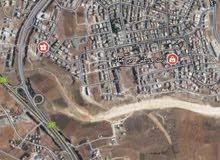 ارض للبيع بدير غبار موقع مميز جدا سكن ب قريبة على شارع المطار