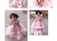 فستان بناتي عرائسي من تصميم نادر الكساري انتاج ازياء الموج الازرق