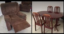 comfortable brown sofa and table with 4 chairs .