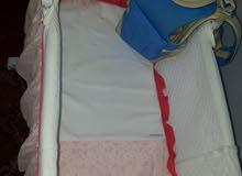 سرير اطفال وسرير فرد واحد
