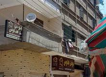 عمارة مكونة من 5طوابق على اربع شوارع بعدد 12شقة و12محل  للبيع قابلة للهدم اول تق