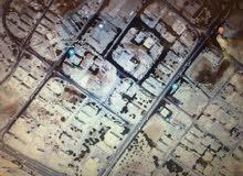ارض للبيع بضاحية الياسمين مساحة دونم سكن ج واجهة 40 متر قرب الحاوز