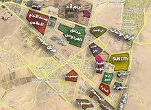 أرض عمارت بمنطقة حدائق أكتوبر المحصورة أ ( حي 401) موقع مميز باقل من سعر السوق