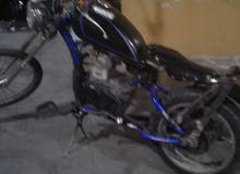 بسكليت راكب عليه ماتور 125 cc