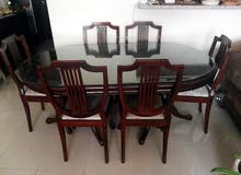 Rose wood dinning table with six chairs Aed 3000