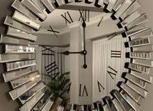 ساعات حائط من المرايا
