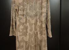 فستان سهرة بحالة ممتازة استعمال ساعة لون روزجولد