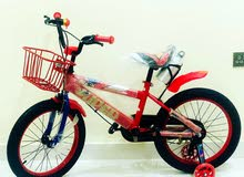 """New cycle for kids size 18"""" red color with LED lights on the side tiers"""