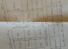 هكتار في وادي الربيع منطقة اللطفة للبيع 3 واجهات