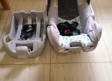 عربة اطفال مع كرسي سيارة