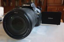 Nikon D5200 camera with two Nikon lenses and Nikon Flash
